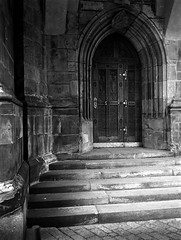 Gothic portal (petr.skuta) Tags: door rodinal fuji gs645s ilford hp5 r09 150 gothic architecture prague monochrome analog analogue selfdeveloped 400 medium format mediumformat 6x45 film negative bw dyi rangefinder church rollfilm fujinon 604