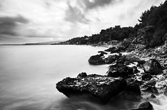 In seclusion (zdenisaba) Tags: kefalonia tide water sea rocks trees beach horizont monochrome sky clouds island seclusion sand
