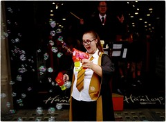 Happiness is Blowing Bubbles (Steve Lundqvist) Tags: bubble bubbles blowing hamleys london londra uk britain british regent street blow gun toy toys game play leica q