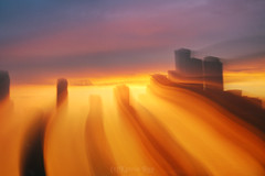 Astro Projection. Golden Sunset Ocean in Mystic City Dimensions (Katrin Ray) Tags: astroprojection goldensunsetoceaninmysticcitydimensions flowingsunsetdimensions city cityscape mysterious sunset light energy mystic layers dimensions blue yellow peachcoloured orange colours castle skyscrapers building construction outofbodyexperience longexposure zooming moving sooconlyaddedmysignature downtown toronto ontario canada katrinray dreamscapesoftoronto icm intentionalcameramovement soocstraightoutofcamera noprocessing lightpainting canon eos rebel t6i 750d canonphotography