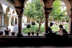 A Time to Rest (Anne Marie Clarke) Tags: cloisters garden rest contemplation couple checkingphone forttryonpark enclosedgarden arches medieval nyc themetcloisters monastery museum three thirds tree