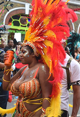 DSC_8302ok Notting Hill Caribbean Carnival London Exotic Colourful Orange Red and Yellow Costume with Ostrich Feather Headdress Girls Dancing Showgirl Performers Aug 27 2018 Stunning Ladies Décolleté Low Neckline Beautiful Breasts Cleavage (photographer695) Tags: notting hill caribbean carnival london exotic colourful costume girls dancing showgirl performers aug 27 2018 stunning ladies orange red yellow with ostrich feather headdress décolleté low neckline beautiful breasts cleavage