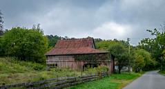 Monroe Barn (Bob G. Bell) Tags: barn fence plankfence farm monroe greenville bobbell xe2 fujifilm clouds sky