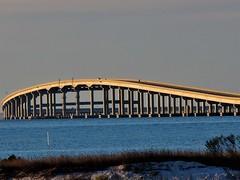 Apalachicola Bay Bridge (ckorfanty) Tags: water blue sky bridge beach sand shore apalachicola stgeorgeisland