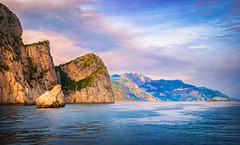 Rugged Amalfi Coast - Textured (byron bauer) Tags: byronbauer amalfi italy coast ocean sea water mediterranean tyrrhenian landscape seascape sky clouds sun shore cliff mountain hill hillside reflection texture painterly evening sunny warm blue pink orange rugged