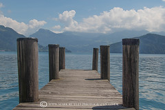 SITTING ON THE DOCK AT THE BAY..... (mark_rutley) Tags: switzerland vitznau lake lakelucerne lucerne travel clouds boat ship maritime sailing cruise dock jetty songtitle pier