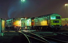 Stratford, East London depot on 5 November1988. Prominent are 47572, 47112 and 31219 gathered around the fuel-point.. (mikul44171) Tags: 30a sf stratford night timeexposure elycathedral exhaust fumes 47572 47112 31219 fuelpoint eastend lights november1988