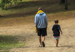Father and Son..... (Kevin Povenz Thanks for all the views and comments) Tags: 2018 august kevinpovenz father son aaron greyson walking dirt road barefoot towel shorts male boy kid man