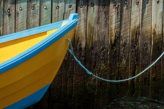 Yellow Boat (Karen_Chappell) Tags: boat yellow blue wharf dock pier newfoundland nfld portugalcove paint painted wood wooden trim rural fishing dory punt canada atlanticcanada harbour avalonpeninsula eastcoast