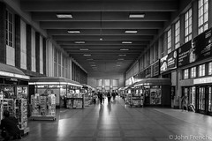 Helsinki Central Station (John French 108) Tags: blackwhite helsinki uusimaa finland station architecture bw monochrome lines building symmetry train pattern urban railwaystation newsstand windows travellers