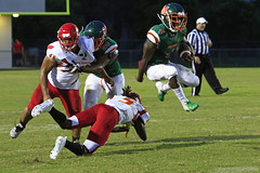 Avoiding the tackle (taddzilla) Tags: mcarthurhighschool mcarthur football mustangs southbroward southbrowardhighschool players jump runningback tackle helmets helmet pad field cleats hollywoood florida 2018 allrightsreserved
