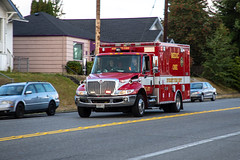 Everett, Washington, USA - 09-10-2018: Emergency Medical Responders racing to the scene of an accident (ShebleyCL) Tags: police hospital everettwashington accident truck emergency medicone firedepartment traffic ambulance