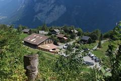 retour à Mex (bulbocode909) Tags: valais suisse mex villages maisons chalets voitures forêts arbres montagnes troncs vert hangars
