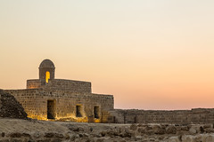Old Bahrain Fort at Seef at sunset (marcinl) Tags: bahrain ancient archaeological architecture bahrainfort buildingexterior castle castlewalls dusk floodlit fort fortifications historic historical illuminated landmark manama nobody old outdoors persiangulf preserved reconstructed remains restored ruin seeffort stone structure sunset tourism tower travel bahrein
