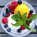 Lemon and mango sorbet with fresh berries