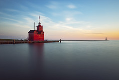 Big Red Stands Still (matthewkaz) Tags: bigred bigredlighthouse hollandharborlight lighthouse red hollandharbor channel lakemichigan lake water greatlakes sky sunset clouds pier longexposure holland michigan puremichigan summer 2018 reflection reflections