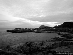 Breakwater and Beyond (liamearth) Tags: earth shore sky mountain sceneic wilderness beautiful sea view outdoor water western landscape wild lofoten norway arctic circle traveling real life camping serene mountainside still clear texture contrast bay rock grass lake rocks clouds coast bw monochrome blackandwhite road seascape boats austvågøy svolvær ocean beach sand breakwater pier beyond harbour port