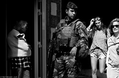 Troops on the street. (Neil. Moralee) Tags: neilmoralee troops military soldier street security sunshine civilian rifle nato europe man woman france italy germany holland young boy candid law enforcemant uniform beret helmet dark crime oppression defence national people black white bw bandw blackandwhite mono monochrome report reportage army marine gun troop force patrol urban threat