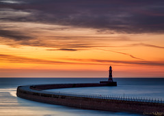 Roker Sunrise (peterwilson71) Tags: arcitecture arch bird clouds city canon6d daybreak exposure reflections beautiful harbour horizon sky landscape longexposure light movement motion northeast outdoors pier rocks sea seashore sunrise travel tide water seascape sunderland
