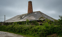Wheal Busy, Chacewater (Rogpow) Tags: chacewater cornwall mine whealbusy tin tinmine cornishmining cornishmines cornishminingworldheritagesite copper coppermine arsenic industrialhistory industrialarchaeology industrial industry fujifilm fuji fujixpro2 abandoned derelict decay disused dilapidated ruin minersdry chimney stack roof overgrown blacksmiths smithy