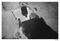 Reflection in the puddle (Aljaž Anžič Tuna) Tags: reflection puddle streetlamp street streetphotography ljubljana silhouette footprint wet photo365 project365 people onephotoaday onceaday 365 35mm 365challenge 365project nikond800 nikkor nice naturallight nikon urban d800 dailyphoto day nikkor28mm 28mm 28mmf28 f28 bw blackandwhite black white blackwhite beautiful
