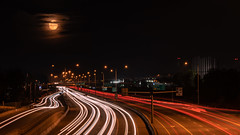 Freeway Moon (Sworldguy) Tags: transcanadahighway highway coquitlam freeway lightstreaks nightscene moon fullmoon outdoor night nightscape citylights longexposure road lanes sonya73 britishcolumbia canada traffic