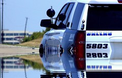 The need of tow truck illusion (MoparMadman63) Tags: illusion creative water road policesuv police suv chevrolet tahoe summer outdoors city dallastx texas abstract