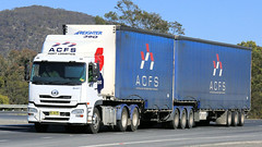 Blue Skies, Blue Sides (5/5) (Jungle Jack Movements (ferroequinologist)) Tags: blue goulburn nsw new south wales boxers creek hume highway kenworth mercedes freightliner ud sims metal transport albury jones yass container freight services hp horsepower big rig haul haulage cabover trucker drive carry delivery bulk lorry hgv wagon road nose semi trailer deliver cargo interstate articulated vehicle load freighter ship move roll motor engine power teamster truck tractor prime mover diesel injected driver cab cabin loud rumble beast wheel exhaust double b grunt