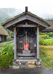 Japanese stone statue in a small shinto shrine, Kyoto Prefecture, Miyama, Japan (Eric Lafforgue) Tags: architecture asia buddhism colorimage countryside curtain day farm figurine house humanrepresentation japan japan18103 japaneseculture kitakuwadadistrict kyotoprefecture miyama nippon nopeople nonurbanscene outdoors photography placeofworship religion roof ruralscene sculpture shintoshrine shrine statue tranquility vertical village jp
