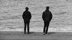 Autumn Afternoon at Portobello 01 (byronv2) Tags: sunny sunlight sunshine autumn portobello edinburgh edimbourg scotland coast coastal sea northsea firthofforth forth rnbforth river riverforth beach portobellobeach blackandwhite blackwhite bw monochrome peoplewatching candid stre