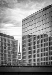 polarity (HiMortl) Tags: hamburg kirche church architektur architecture city stadt schwarzweis blackandwhite monochrome hochhaus skyscraper glas sony alpha sonyilce6500 6500 apsc fe85mm18
