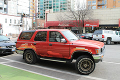 The Art Of Taping One's Vehicle (Flint Foto Factory) Tags: chicago suburb evanston illinois suburban urban college town spring march 2017 downtown 1990 1991 toyota 4runner suv sports utility vehicle sooc straightoutof camera front threequarter view japanese import us market bennisons bakery 1000 davisst maple intersection street parked parking parallel bicycle bike lane new construction road grass lemoi ace hardware store 1008 davis rust red duct tape