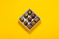 Assortment of luxury bonbons in box on bright yellow background (Aleksa Torri) Tags: chocolate box candy background bonbon sweet praline gift dessert luxury food golden brown delicious collection truffle above assortment bitter chocolatefactory chocolatier color concept confection confectionery copyspace creative exclusive filling french geometric green handmade minimal minimalism original painted pastry pastrychef patisserie popart premium present recipe romantic stilllife template topview yellow bright