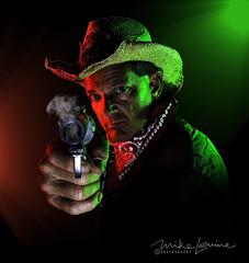 DSC_6089 (mikeyasp) Tags: headshoulders cowboyhat smokinggun gels coloredgels flash smoke gunfighter sixshooters gunslinger western pose portrait layers photoshop