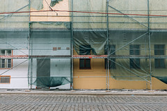 Scaffolding (Tim Bow Photography) Tags: timboss81 tim bow photography timbowphotography streetphotography street moments prague czech republic city momentsinacity streetstyle desolate canon welshphotographer scaffolding scaffold work netting windows doors unfinshed