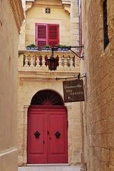 Malta Streets (Douguerreotype) Tags: street city window balcony buildings malta architecture red sign door