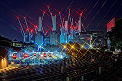 Night Lights (Geoff Henson) Tags: lights starburst railway tracks trains locomotiveshed depot sidings points reflection powerstation building architecture chimneys signals cranes glow