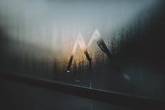 Mountain sunset (Weisimel) Tags: raining rain nature mountains window glass nikon d800 sun faded trees water hutte