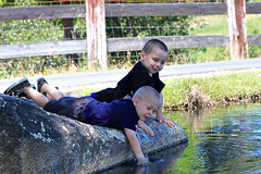 Boys Playing In The Water 3274 (casch52) Tags: child boy kid cute water fun summer young happy lifestyle little childhood people care can nature person blue background garden growth beautiful plant natural children spring funny caucasian play joy family adorable smile one cheerful leisure green outdoors preschooler happiness rock