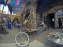 Shops in the Market - Rissani, Morocco (TravelsWithDan) Tags: men market shops arabic bicycle open metalworks rissani morocco africa candid gopromark4black ngc