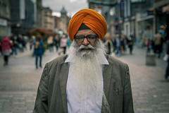 Orange (Leanne Boulton (Away)) Tags: people portrait urban street candid portraiture streetphotography candidstreetphotography candidportrait streetportrait streetlife old man male face expression mood feeling beard orange turban sikh tone texture detail depthoffield bokeh naturallight outdoor light shade city scene human life living humanity society culture lifestyle canon canon5dmkiii 70mm ef2470mmf28liiusm color colour glasgow scotland uk
