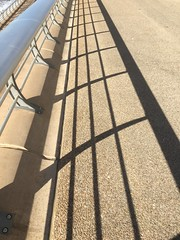 Shadows on the Seafront. (Bennydorm) Tags: railings parallellines sunny prom iphone6s september septembre inglaterra inghilterra angleterre europe uk gb britain england lancashire blackpool resort barrier fence shadows seafront