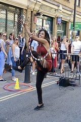 """""""Put a coin in my hat and all your dreams will come true"""" Brick Lane, Spitalfields (Yekkes) Tags: circus juggling hoops dancer mysterious mystique fun bricklane eastend london dance spitalfields city street urban"""