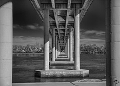 Real Life Is Like It Looks Under This Bridge, Crossing One-to-One The Obstacles to Achieving Our Dreams. (Ramiro Francisco Campello) Tags: columnas pilares blancoynegro portales obstáculos hope faith water rionegro river puente grenuol ramirofranciscocampello argentina buenosaires patagones carmendepatagones blackandwhite metas bridge sueños dreams