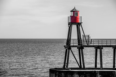 Whitby-7695 (timbertree9) Tags: whitby northyorkshire northsea whitbyharbour seaside seafront sea blackandwhite monochrome mono england unitedkingdom greatbritain sky lightandshade selective selectivecolour lighthouse red water pier