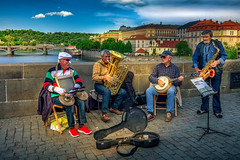 Ragtime on the bridge (grantthai) Tags: musician musicians bridge prague charles karlov men banjo saxophone river boat tuba brass instruments scene street