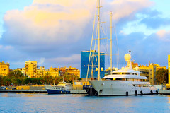 Barceloneta Sunset (Fnikos) Tags: sunset sky skyline cloud port porto puerto harbour ship boat sea water waterfront city building architecture tower outdoor
