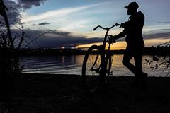Cyclist by a lake Kallavesi in the evening (VisitLakeland) Tags: finland kuopio lakeland summer auringonlasku evening ilta järvi kesä lake luonto maisema nature outdoor scenery silhuet siluetti sunsets water