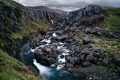 On Hengifoss Track (azhukau) Tags: hengifosstrack iceland nature mountain outdoors landscape scenics rockobject river water summer waterfall hiking beautyinnature stream valley travel nopeople grass greencolor mountainrange canyon hike steep scenery rocky