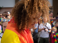 Cardiff Pride 2 (Nikonsnapper) Tags: olympus omd em1 zuiko 45mm cardiff pride parade colour candid street curls colourful beauty shy primelens
